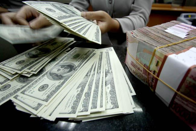 Dolar Cemas Akibat Konflik Perdagangan AS Dengan Cina